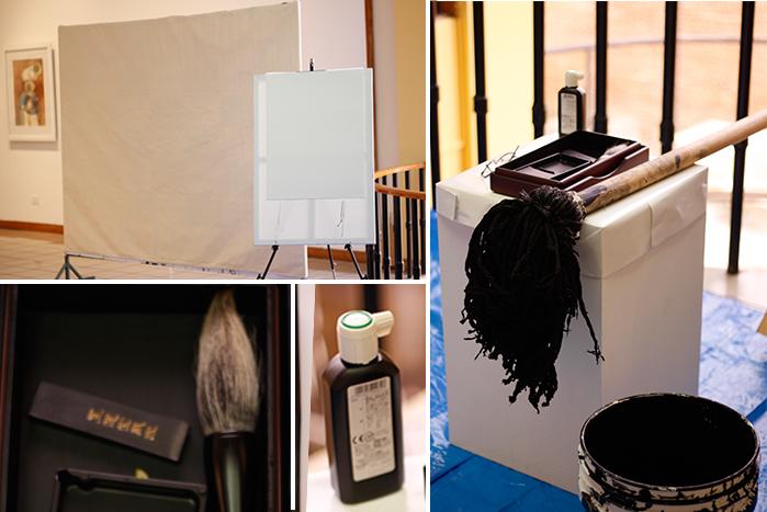 Todo listo para empezar: papel, bastidor, pincel de cola de caballo, tinta china y pincel gigante.